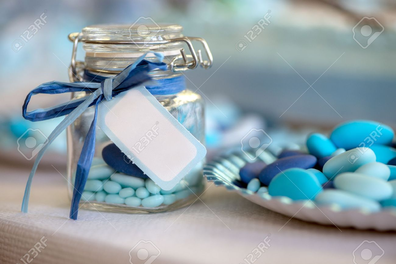birth in light blue candy container glass and paper plate Stock Photo - 21139722