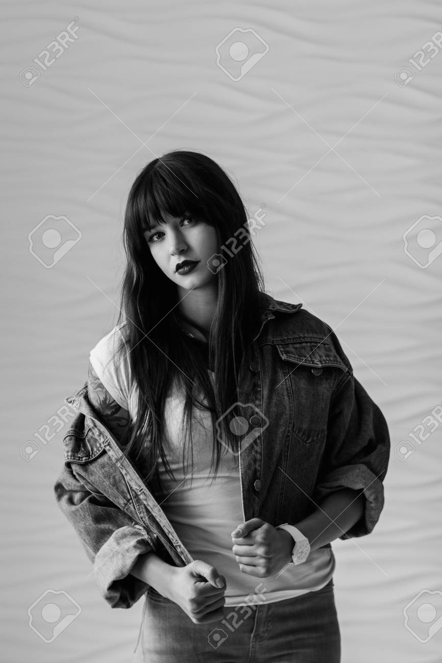 Black and white portrait of beautiful young woman dressing in 90s style fashion stock photo
