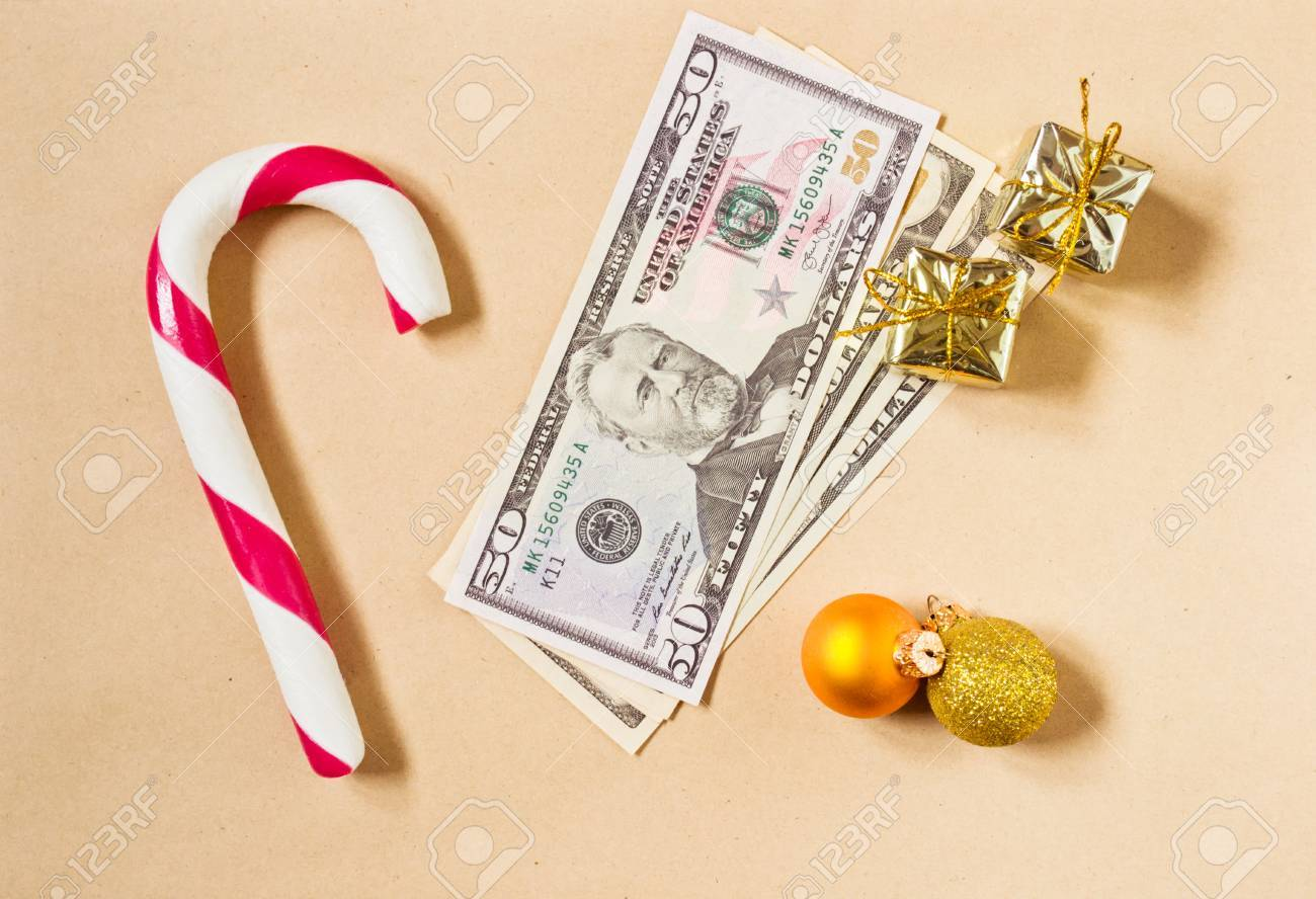 Christmas Candy Cane With Money Gift As A Holiday Background Stock ...