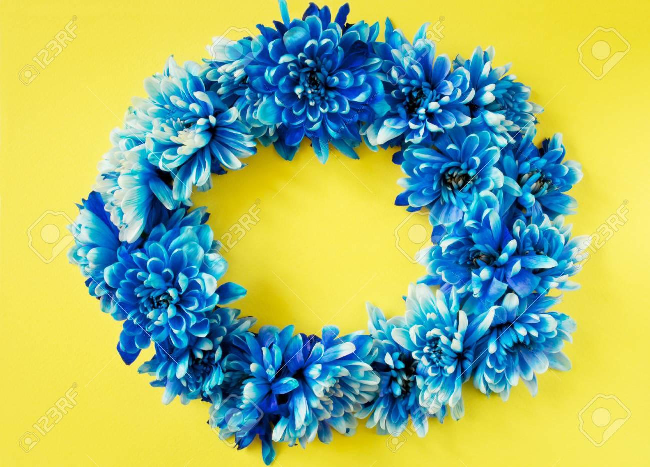 Pretty blue flower wreath on a yellow background stock photo pretty blue flower wreath on a yellow background stock photo 51600444 izmirmasajfo