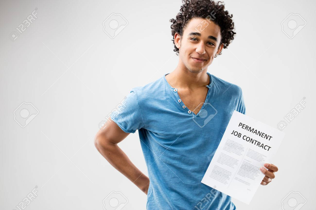 permanent job contract shown by a very happy young man stock photo stock photo permanent job contract shown by a very happy young man