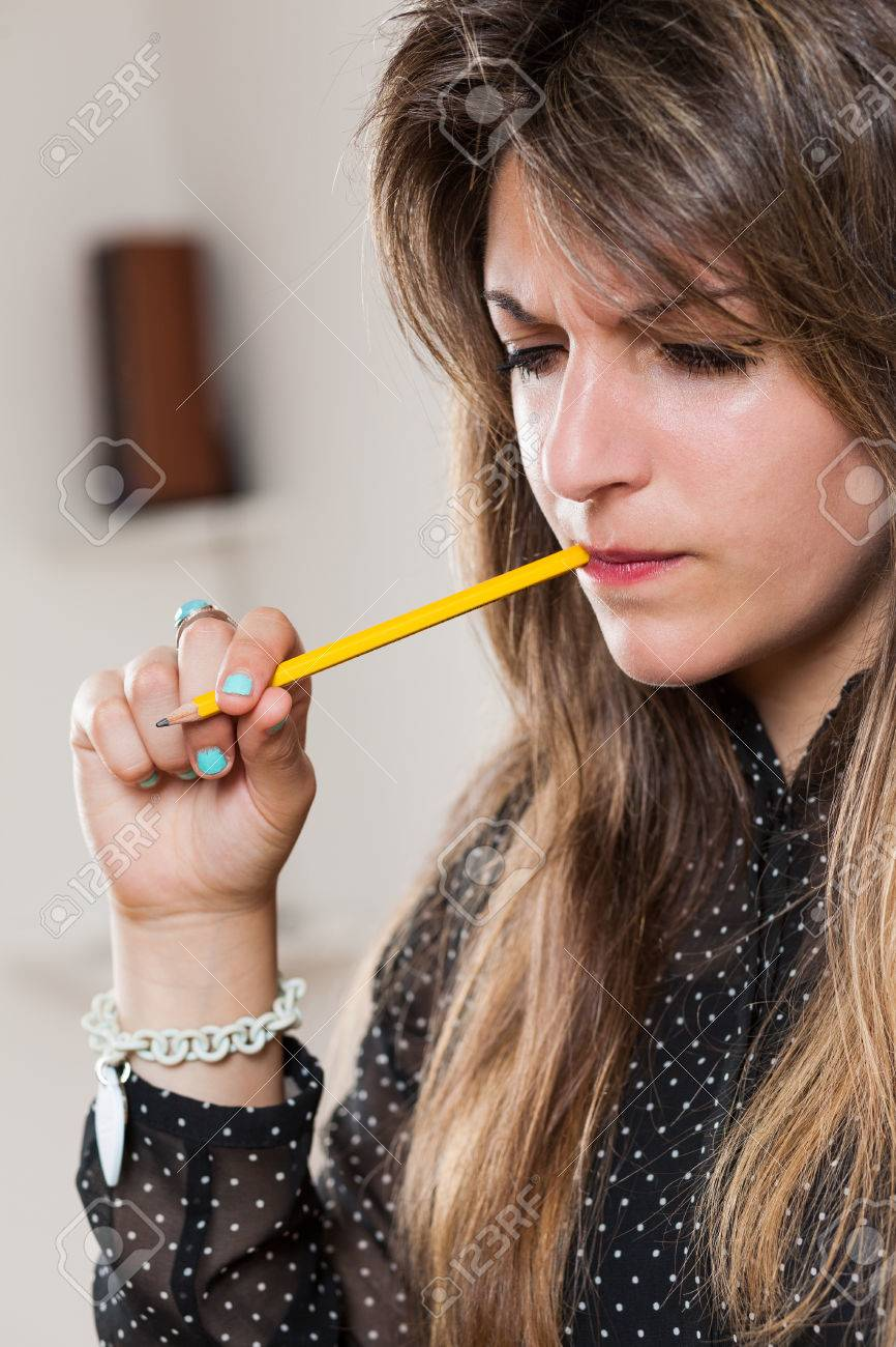 biting pencil woman is a student or a business woman stock photo picture and royalty free image image 56755469