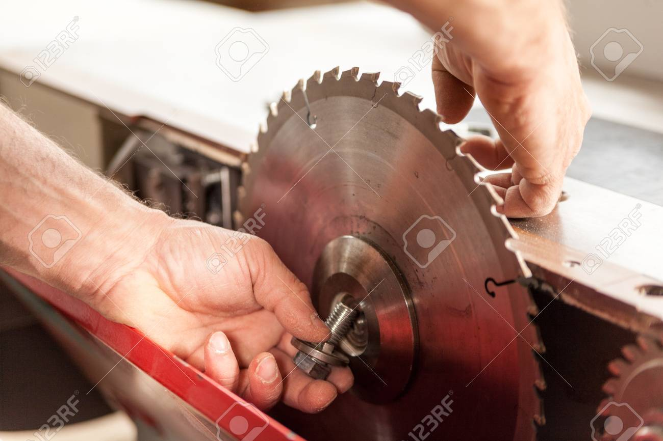 Hands of a woodworker changing a sawblade for his stock photo hands of a woodworker changing a sawblade for his stock photo 66662187 greentooth Image collections