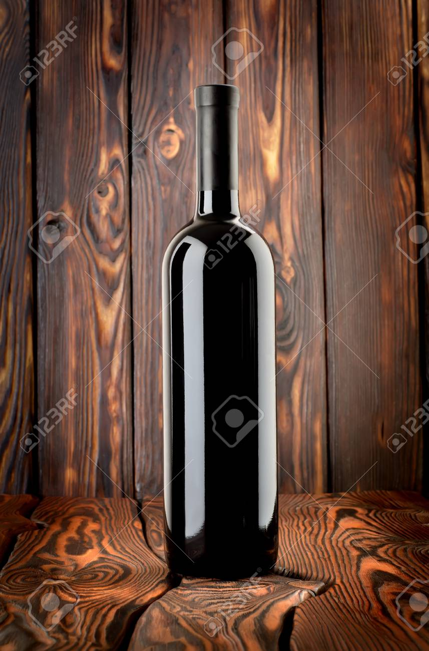 Bottle of red wine on the table Stock Photo - 13910549