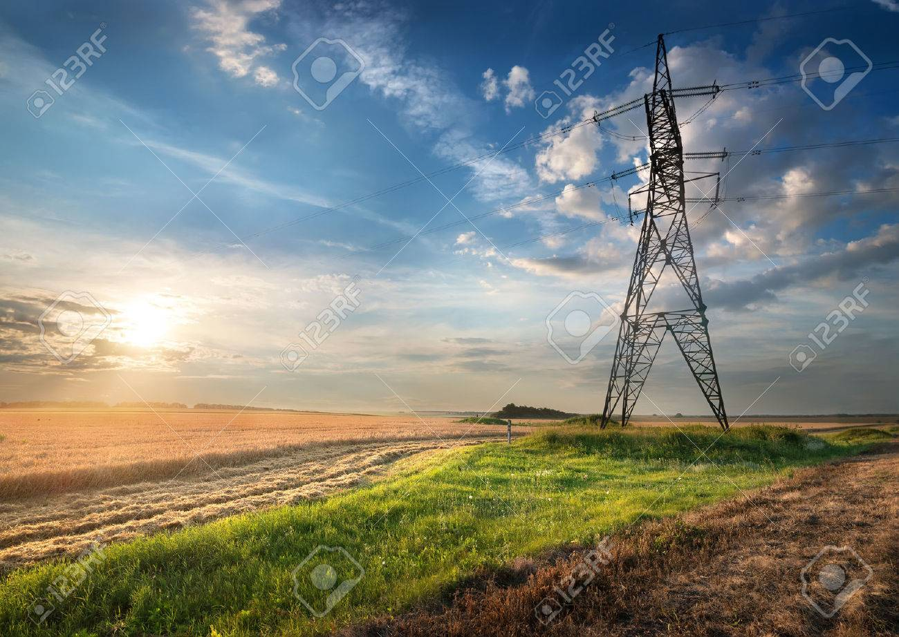 Electric pole in the autumn field at sunrise - 34349209