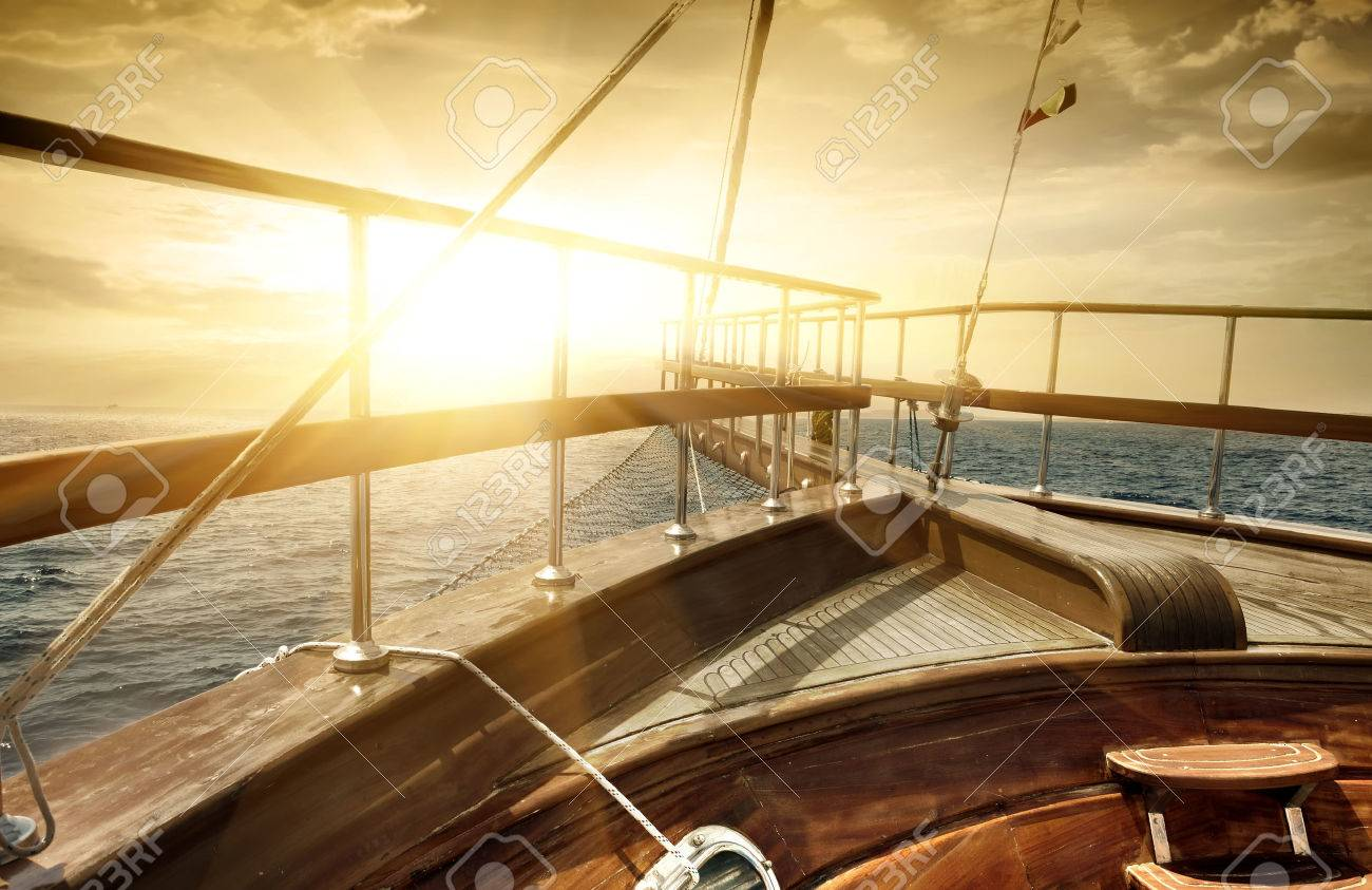Ship in the sea in sun beams - 48196167