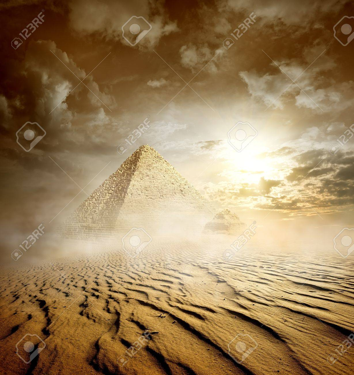 Storm clouds and pyramids in sand desert - 50375156