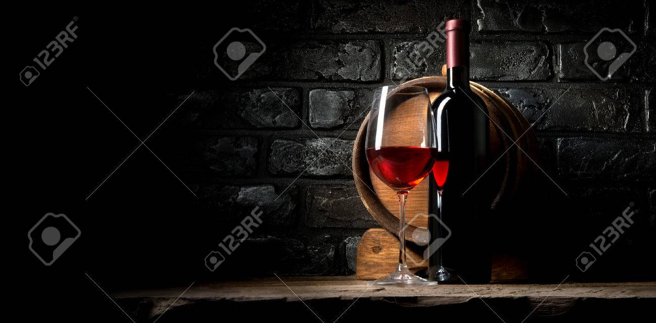 Red wine on a background of old black bricks - 52587528