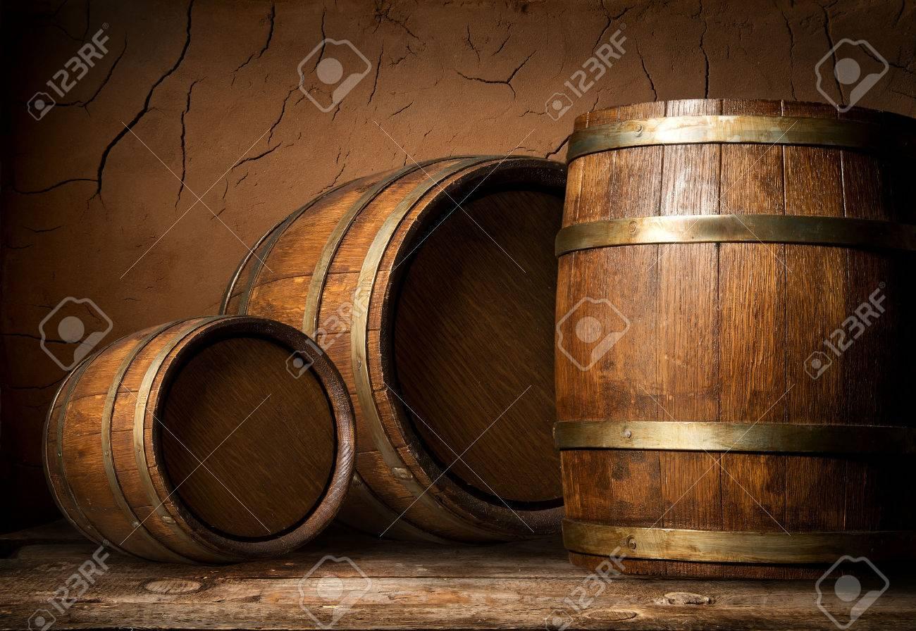 Three wooden barrels near clay wall in cellar - 54270246