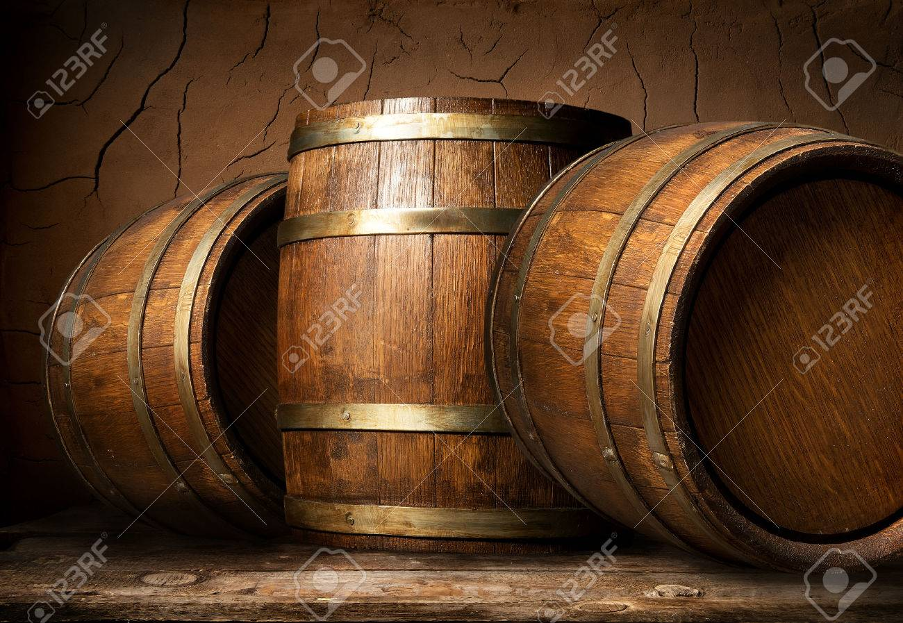 Old wooden barrels in cellar with clay wall - 54300853