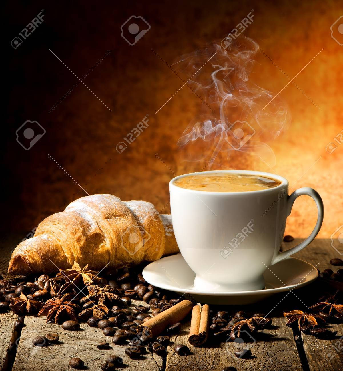 Fresh croissant and coffee with spices on table - 54300946