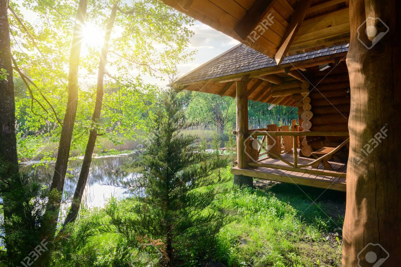 Wooden house and river - 97508779