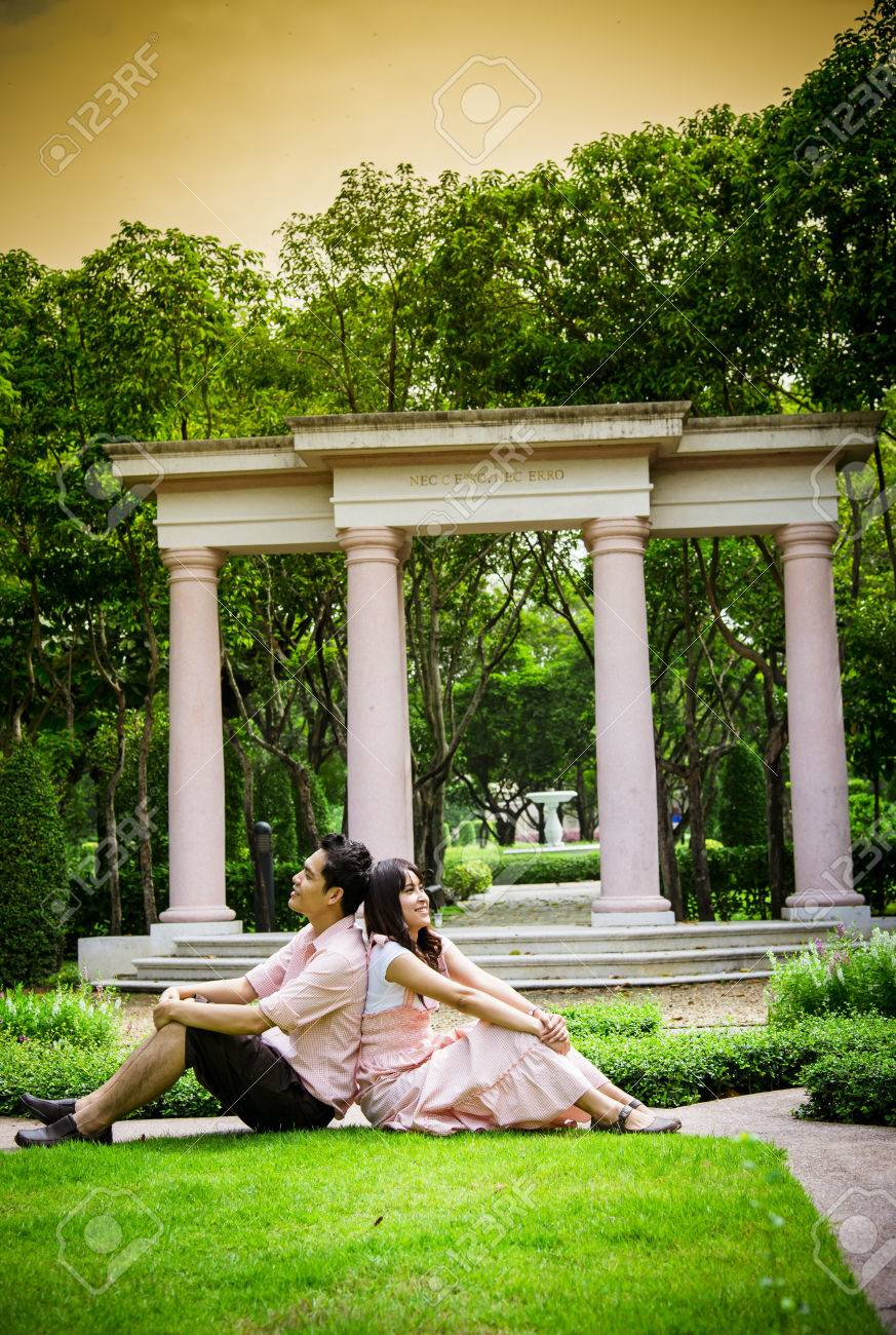 Lover Couples Sit In The Garden Stock Photo   26075667