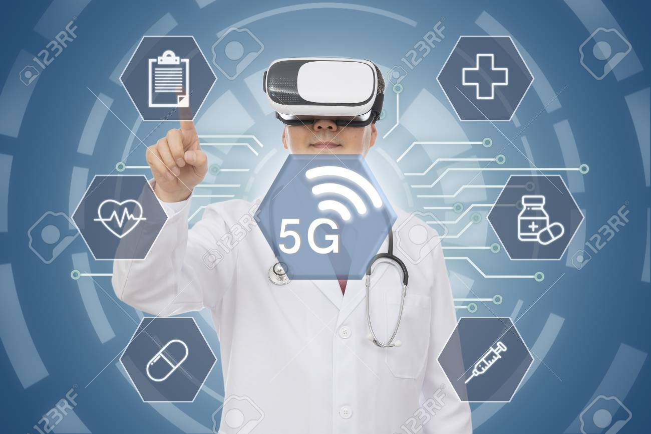 Male doctor wearing virtual reality glasses. 5G Medical Concept. CG - 122653645
