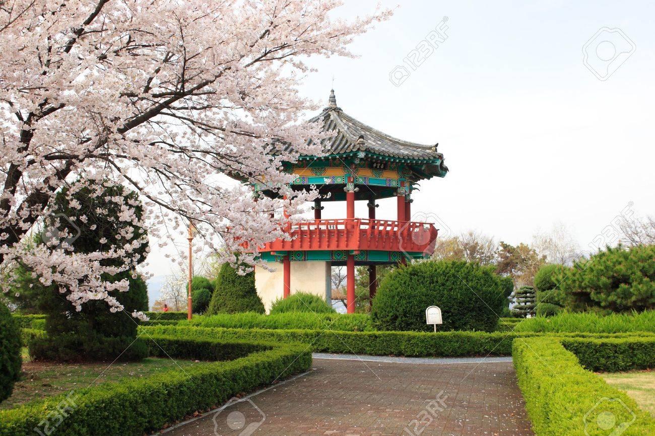 A brick path leads to a Korean pavilion. - 3119734