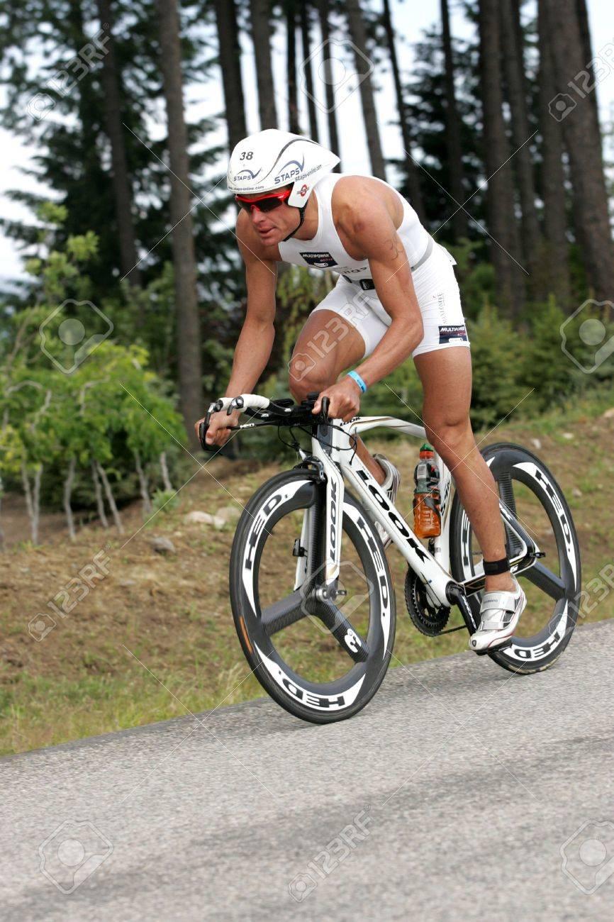 Pro triathlete Maximillian Longree of San Francisco, CA on the bike portion of the Ironman Triathlon in Coeur d'Alene, Idaho. 06/21/2009 - 6886184