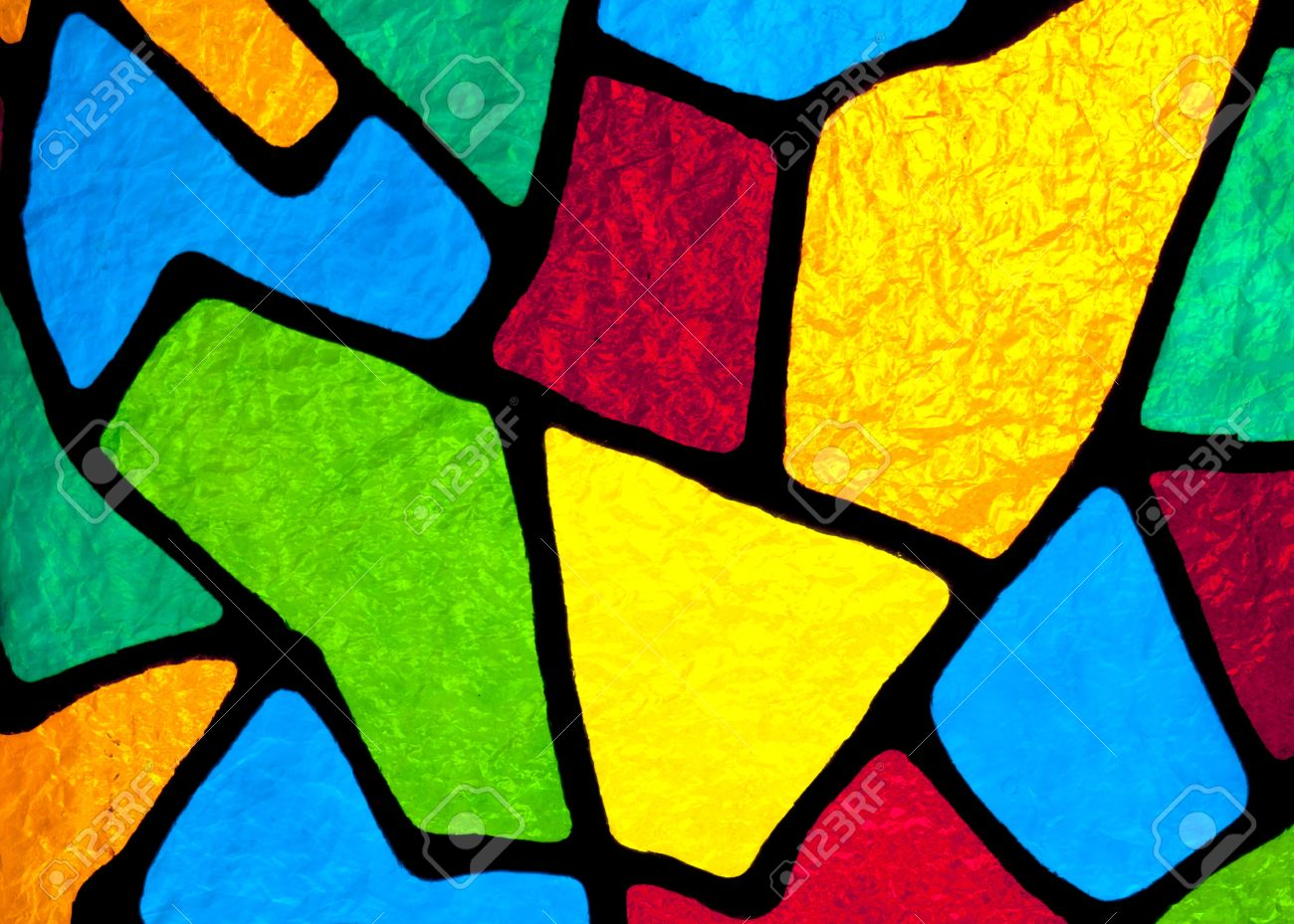 Multi colored stained glass inside a church that is backlit by the sun light. - 8736288