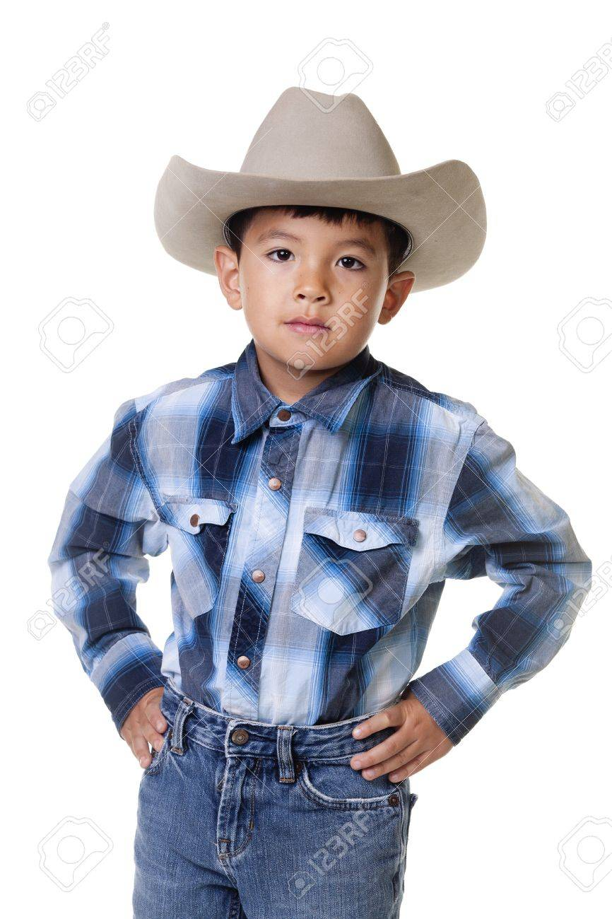 41902216ce Foto de archivo - Un niño vestido con ropa de vaquero.