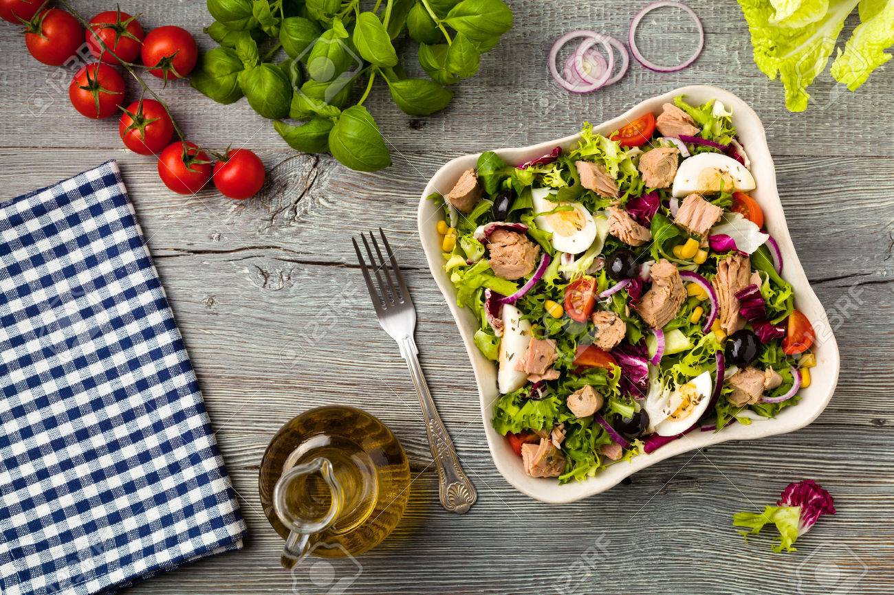 Tuna salad with lettuce, eggs and tomatoes. - 50592738