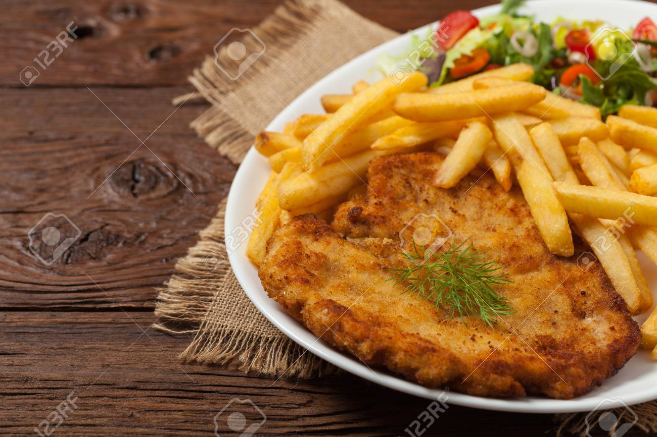 Chicken Schnitzel Served With Fries And Salad Natural Wooden Stock Photo Picture And Royalty Free Image Image 82107045