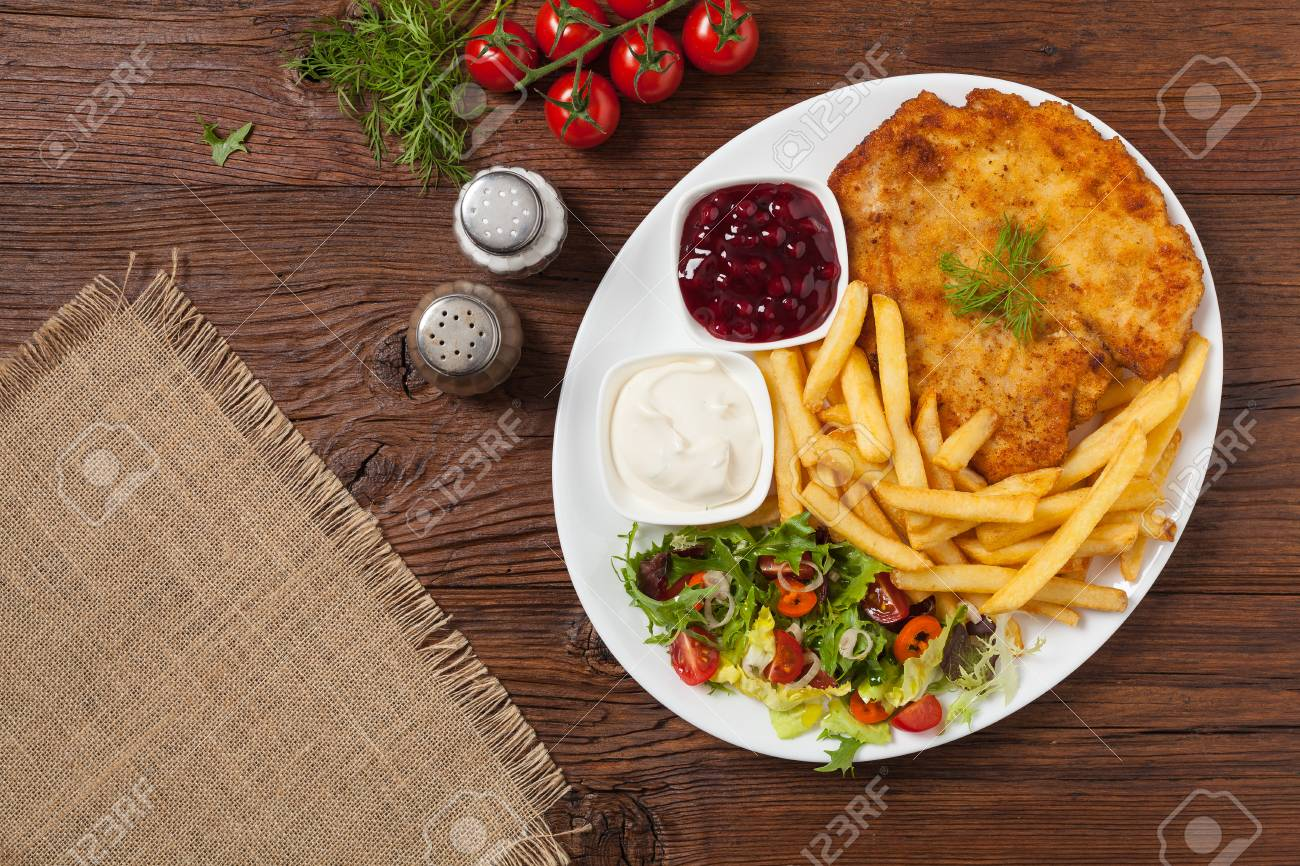Chicken Schnitzel Served With Fries And Salad Natural Wooden Stock Photo Picture And Royalty Free Image Image 89027639
