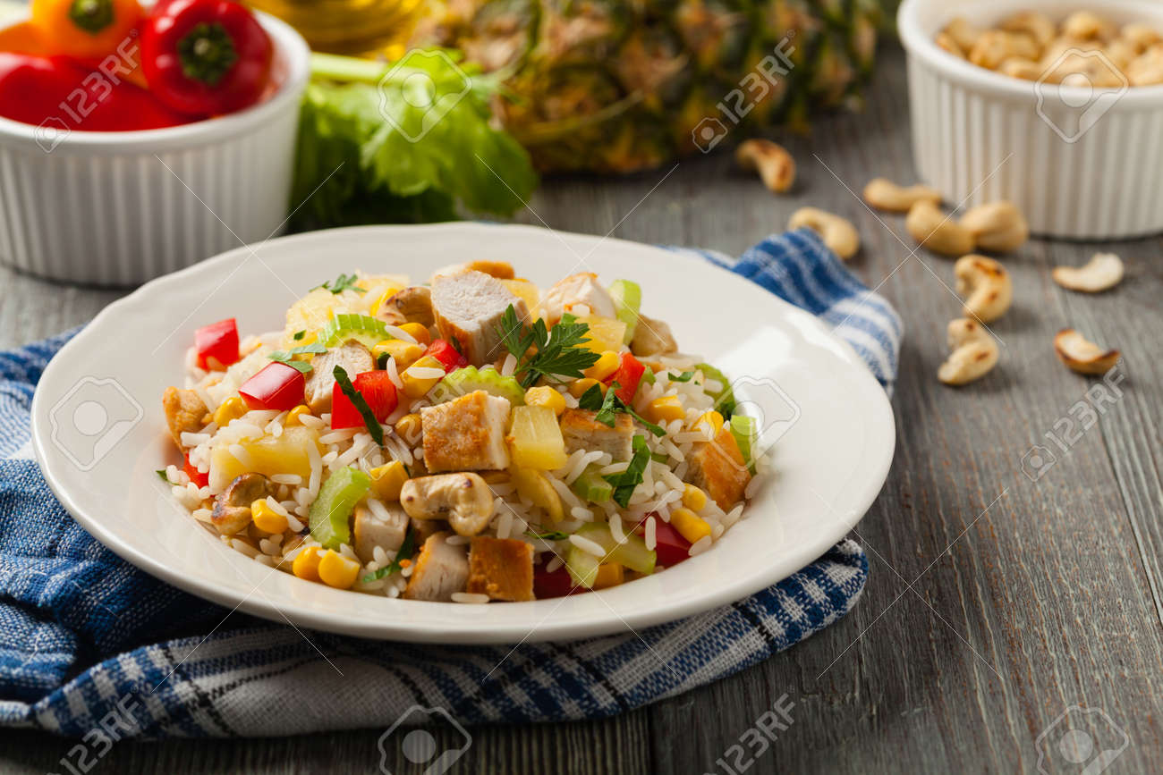 Salad with rice, chicken, peanuts and vegetables. Front view. - 169533687