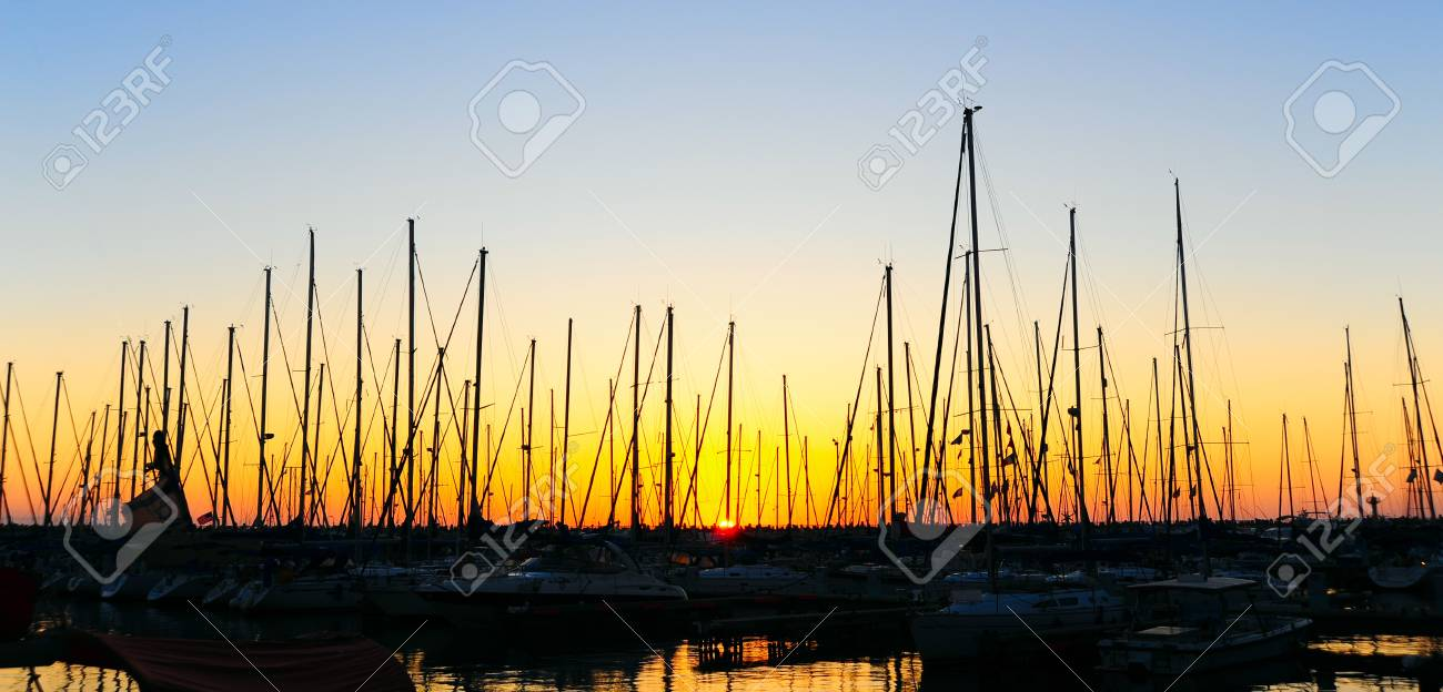 Marina With Docked Yachts At The End Of The Day. Stock Photo - 12396250