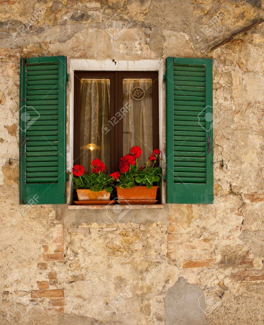 Window on the Facade of the Old Italian Home Stock Photo - 16990393