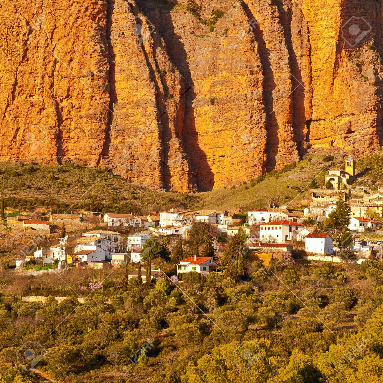 Rocks In Spanish Part - 26: Spanish Medieval Village At The Foot Of The Rocks In The Pyrenees Stock  Photo - 31309092