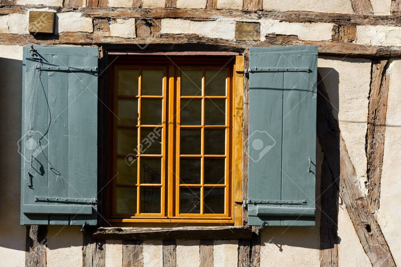 French Window With Open Wooden Shutters