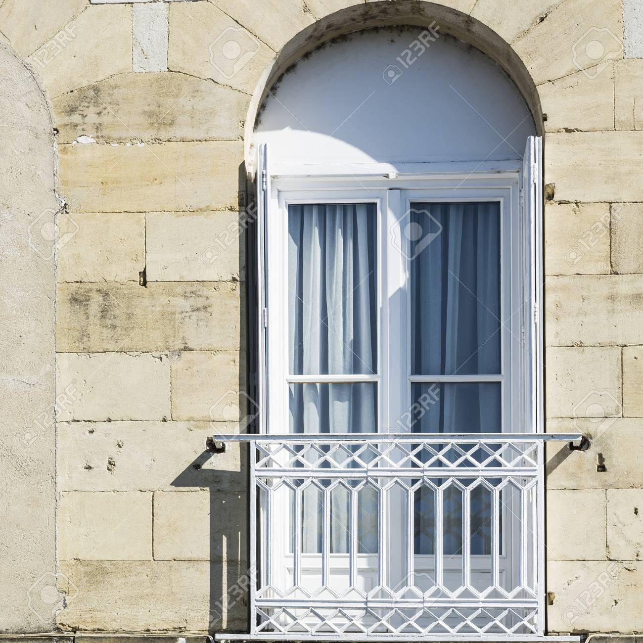 Classic european architecture in France  French window with light