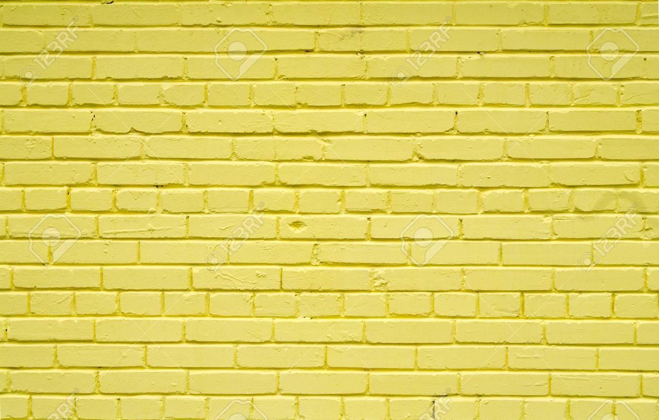 Vieux Mur De Briques De Briques Peintes Avec De La Peinture Jaune Pour Textures Ou Arrière Plans