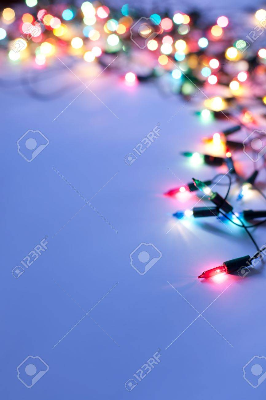 Christmas lights on dark blue background with copy space Stock Photo - 10332032
