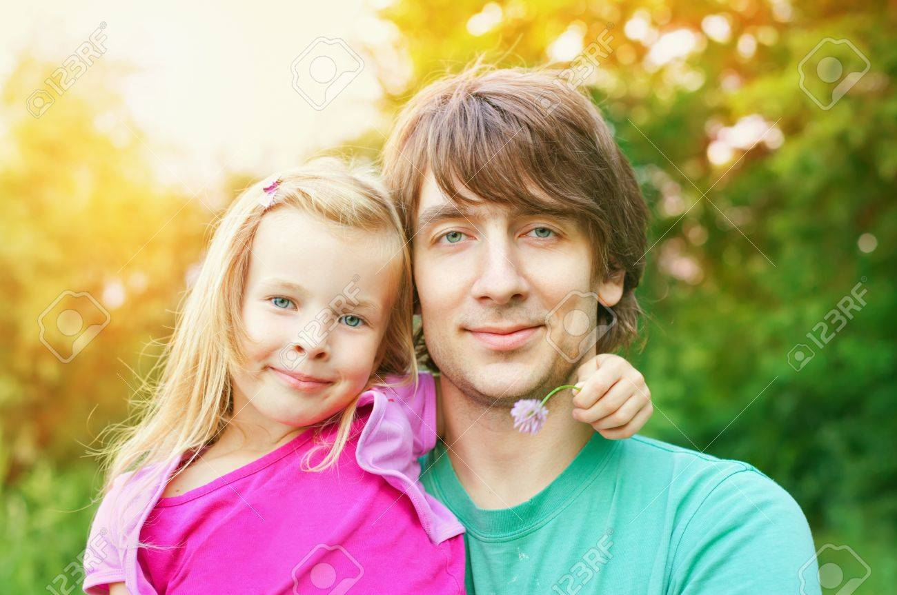 father and daughter.Young man and beautiful little girl outdoors in park  in summer Stock Photo - 10332235