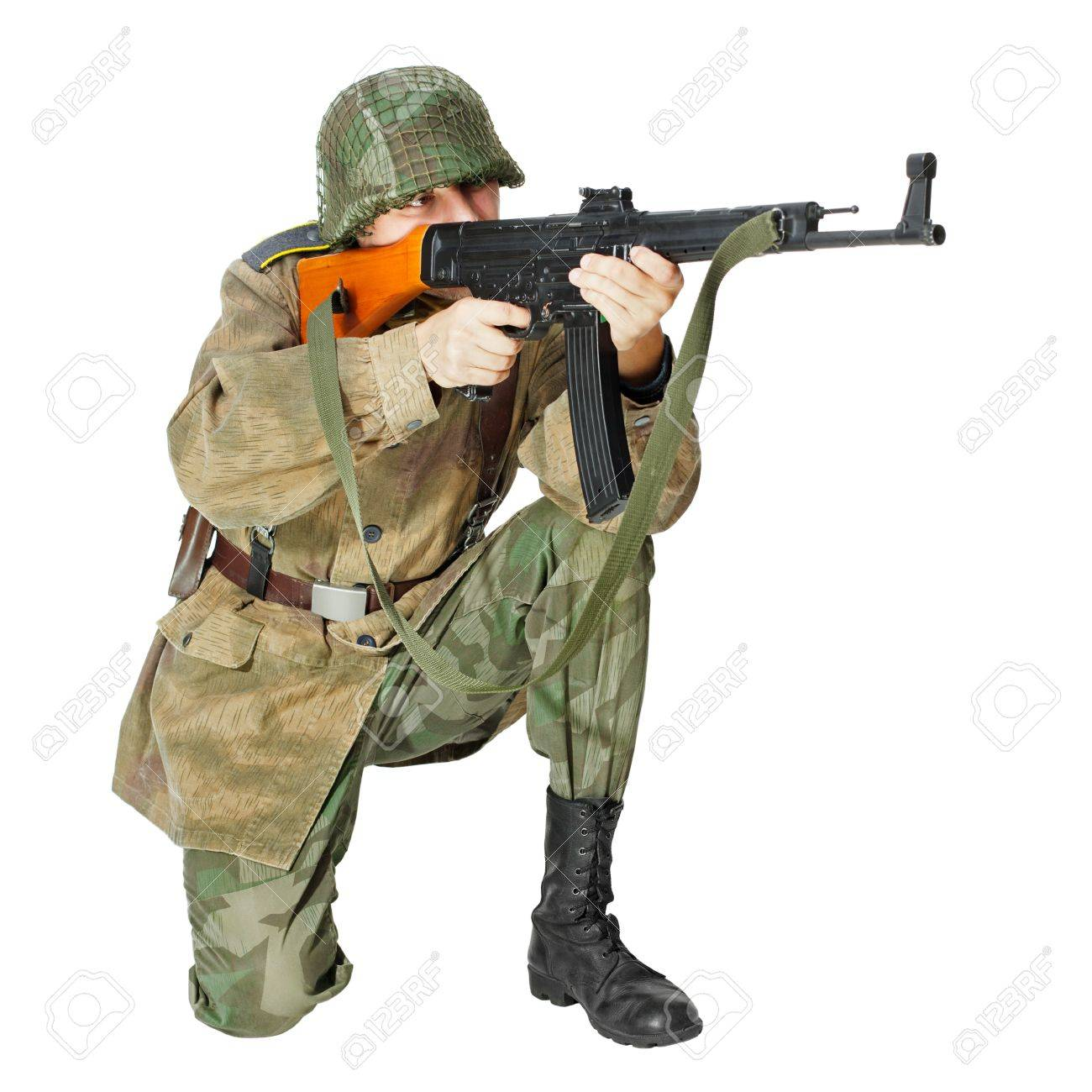 Soldier with submachine gun, second world war style  Isolated on white background Stock Photo - 17478069