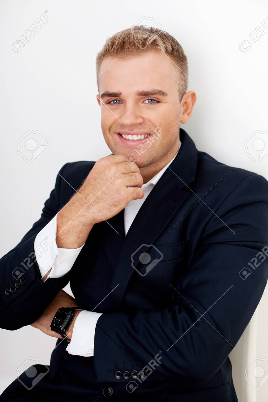 Portrait of happy smiling young businessman Stock Photo - 18355373
