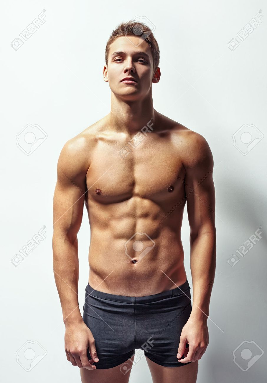 Portrait Of A Young Muscular Man In Underwear Against White Wall Stock Photo Picture And Royalty Free Image Image 27880850