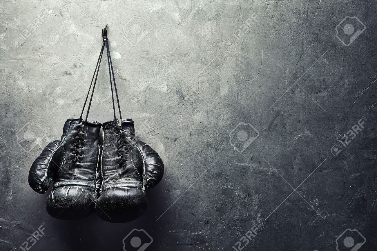 old boxing gloves hang on nail on texture wall with copy space for text Retirement concept - 28679590