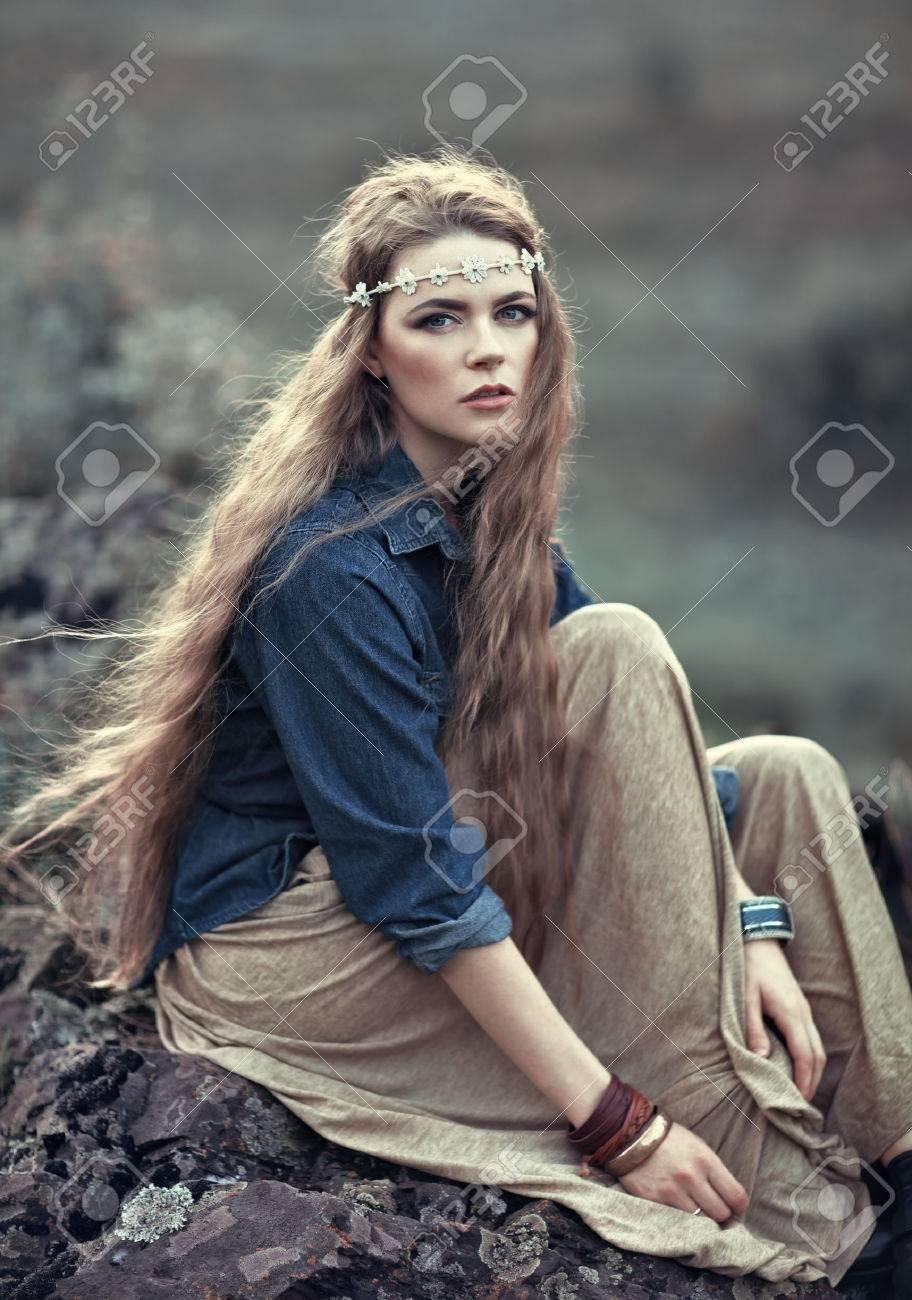Beautiful hippie girl sitting on stone. Boho fashion style - 32467105