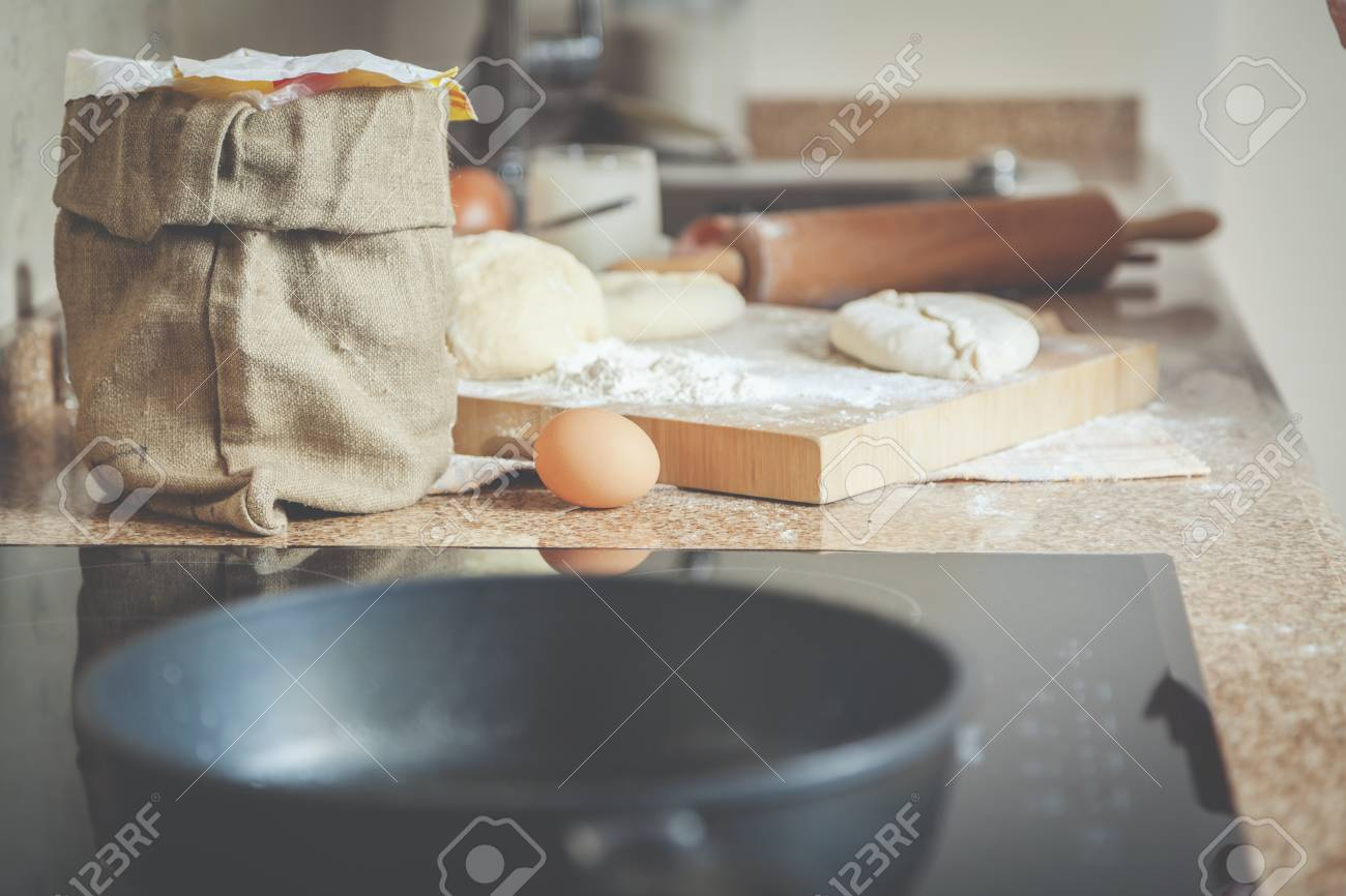 Bag Of Flour, Egg, Board With Roasted Patty Lie On The Long Marble Table