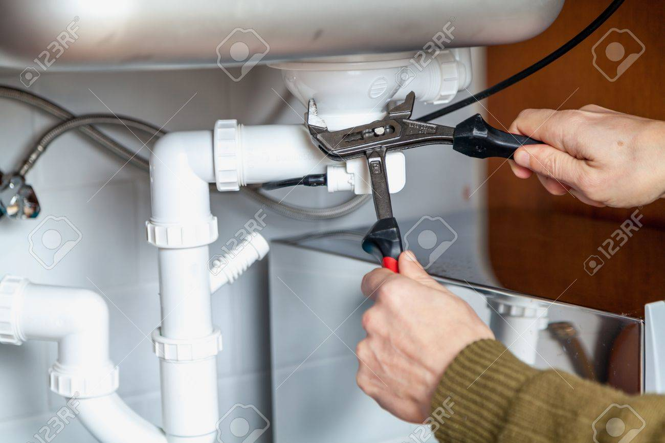 Repair Of Hydraulic Valve Kitchen Sink Using A Pipe Wrench Closeup Stock  Photo   86501377