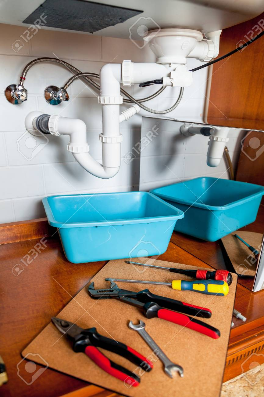 Repair Of Hydraulic Valve Kitchen Sink. Set Of Keys And Screwdrivers ...