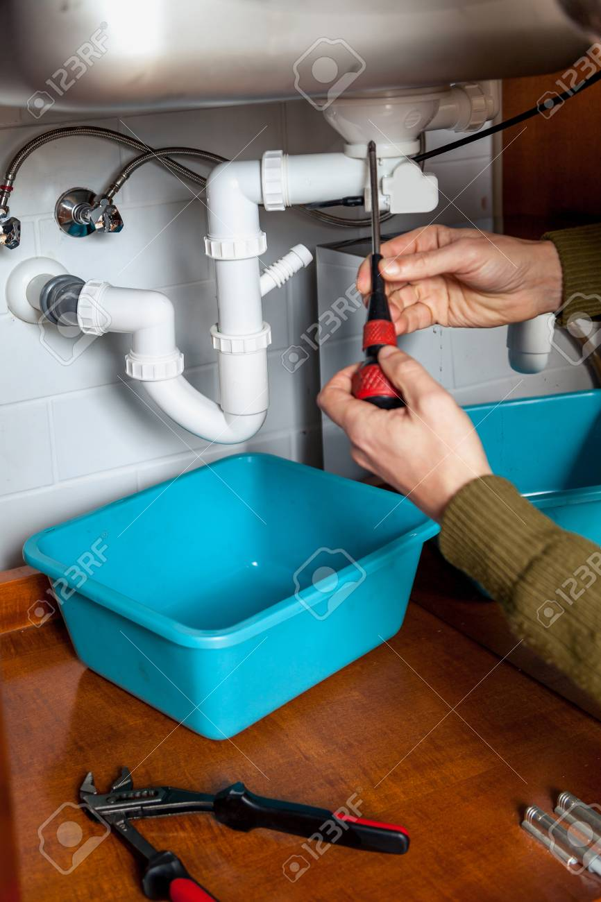 Repair Of Hydraulic Valve Kitchen Sink With A Screwdriver Stock ...