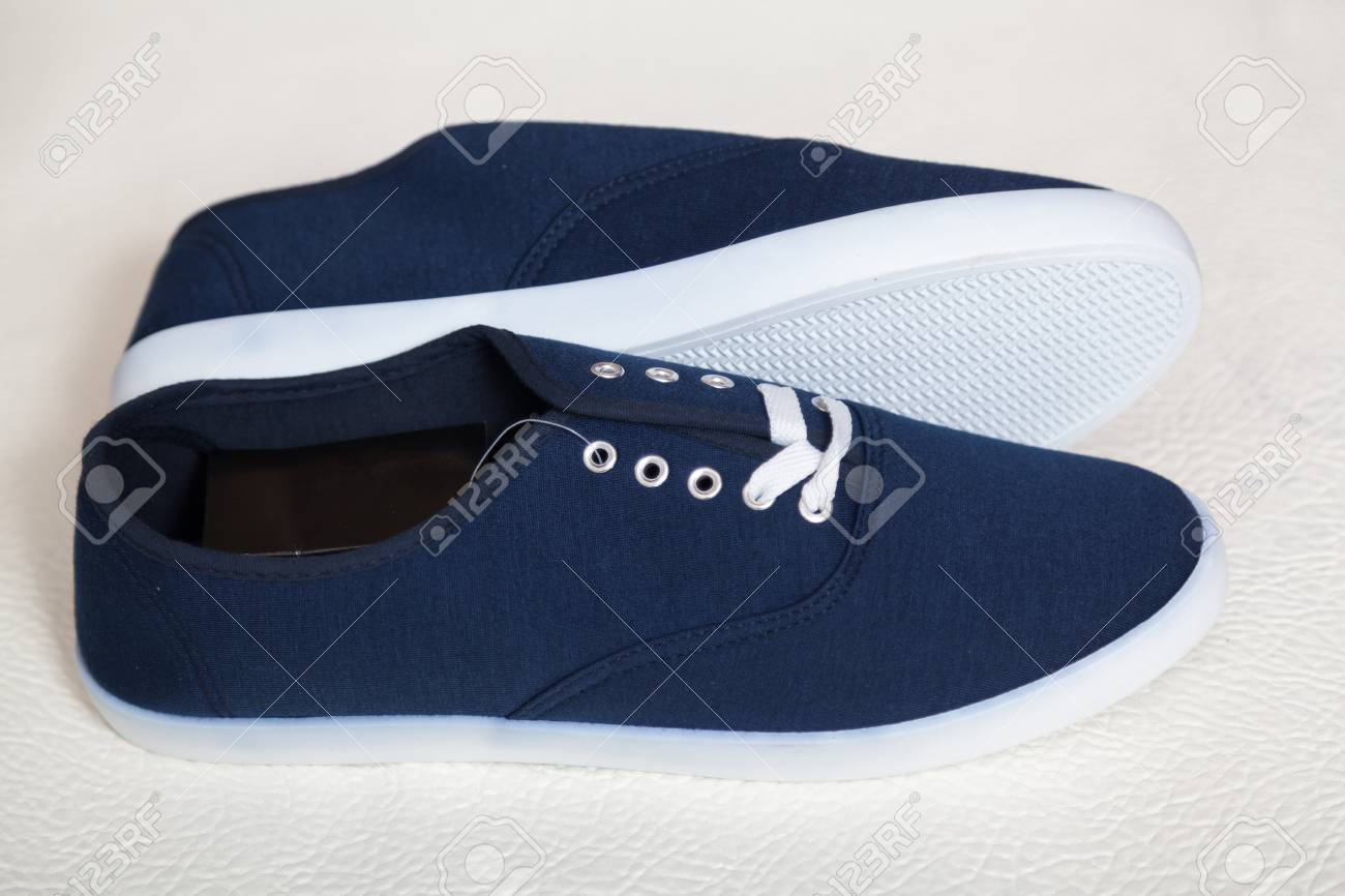Two New Blue Sneakers With White Soles