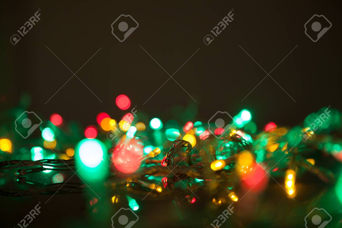 Colorful Christmas Lights Background.Colorful Christmas Lights Shiny Leds On Black Background