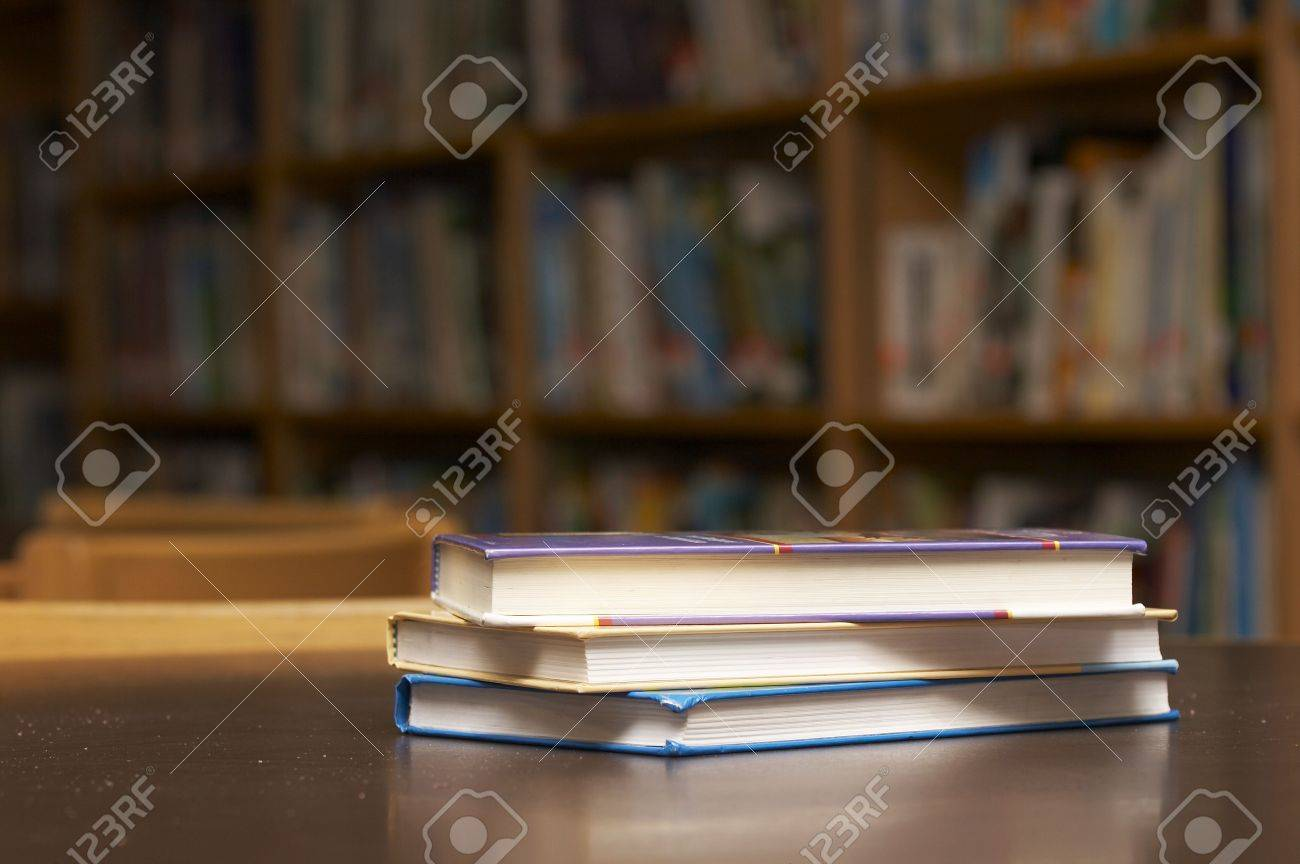 three books stacked on a table Stock Photo - 1895814