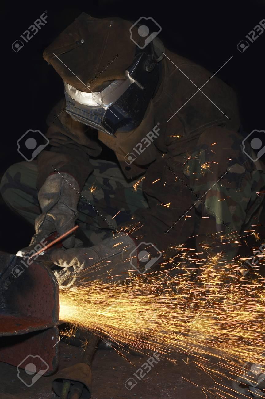 an arc welder spraying a lot of fire