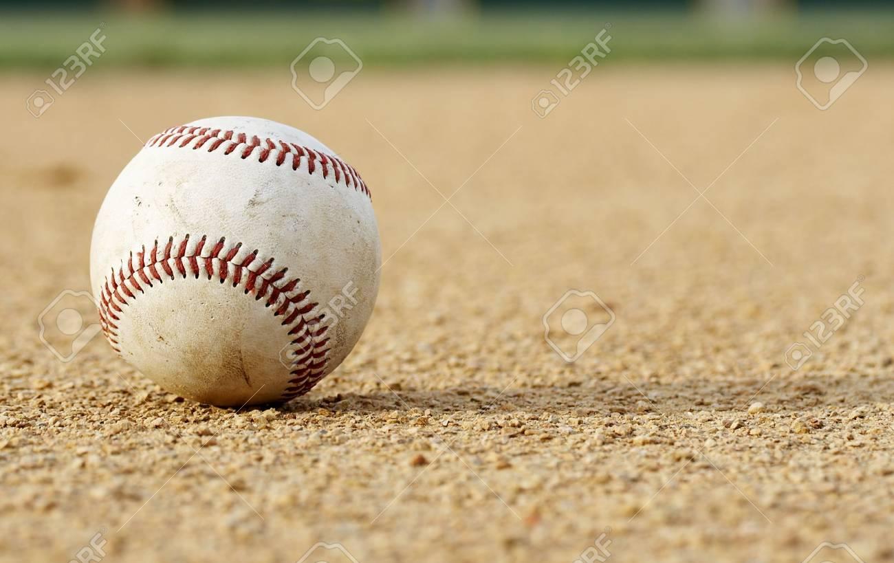 one baseball on infield of sport field Stock Photo - 3776589