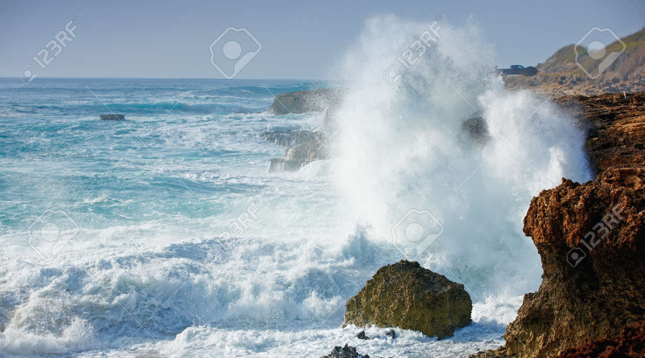 At photo of wild waves, stormy weather and rocks - Oahu, Hawaii