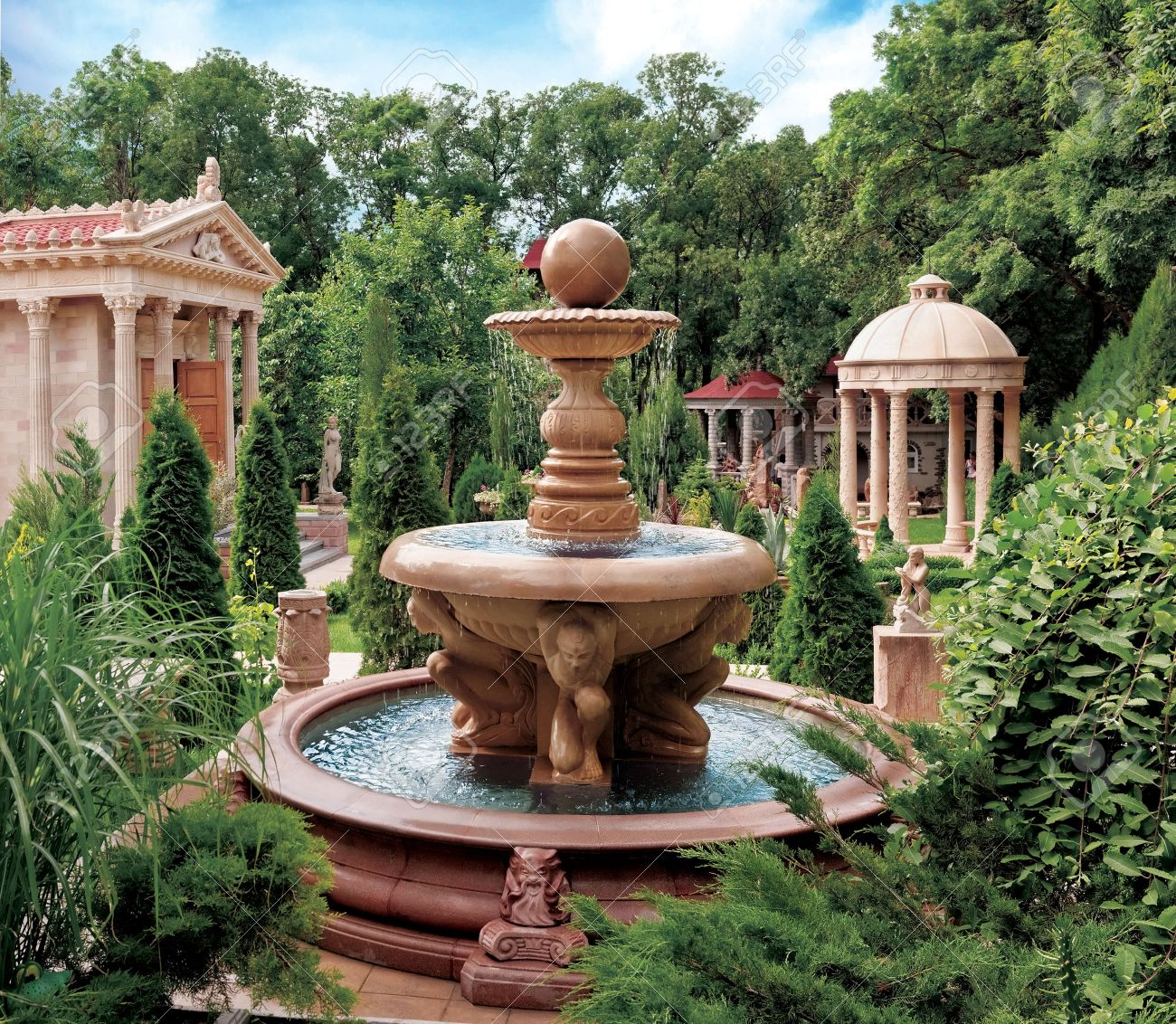 Water Fountain In Old Park. Scenic View Of Decorative Water Fountain And  Structures In Old